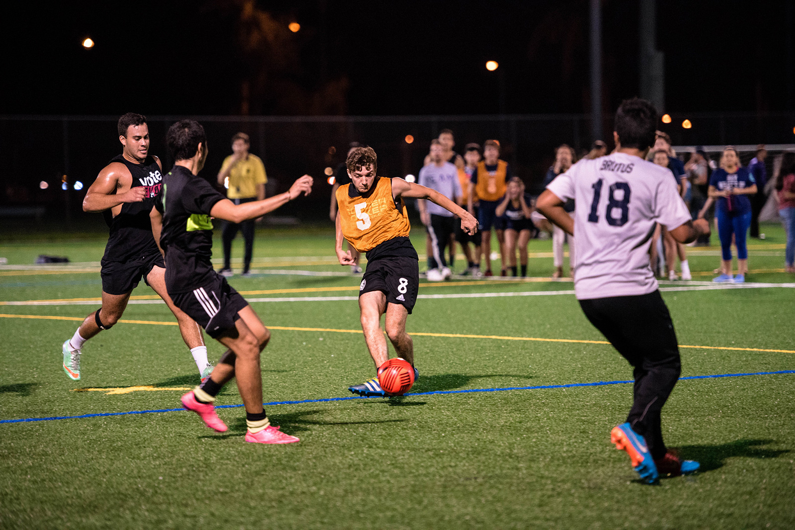 Intramural soccer players relax on a soccer field